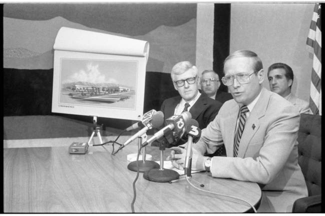 Gov, Richard Bryan speaks at a press conference with a rendering of a Citibank building in 1987 ...