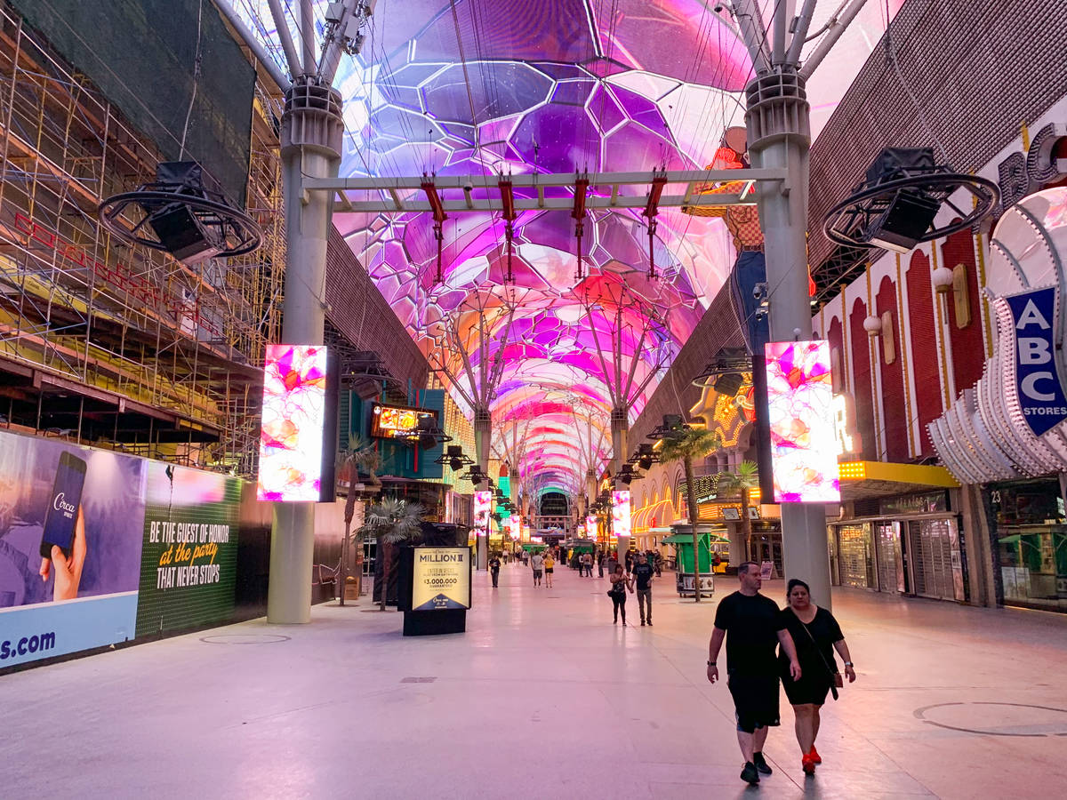 People walk along the Fremont Street Experience after casinos reopened in downtown Las Vegas on ...