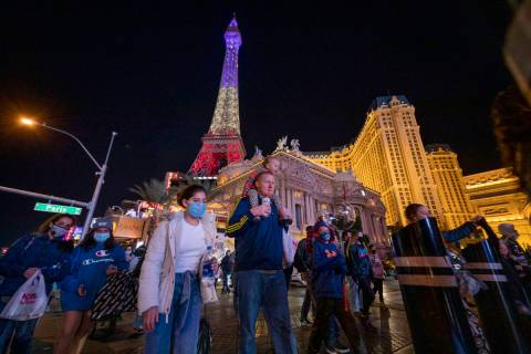 Tourists walk down Las Vegas Blvd., on the Strip, Friday, Nov. 27, 2020, in Las Vegas. (Elizabe ...