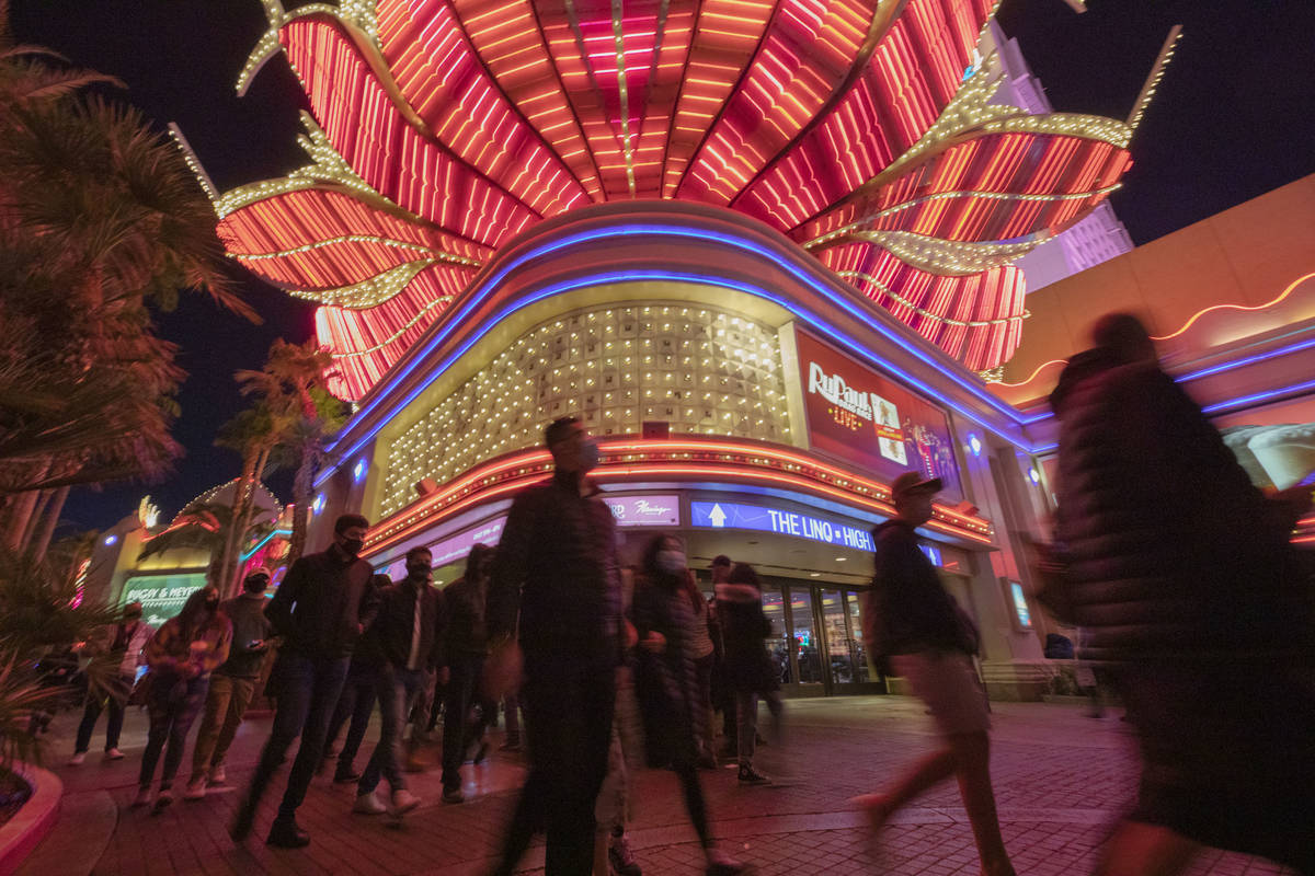 Tourists walk near the Flamingo casino-hotel on the Strip on Friday, Nov. 27, 2020, in Las Vega ...