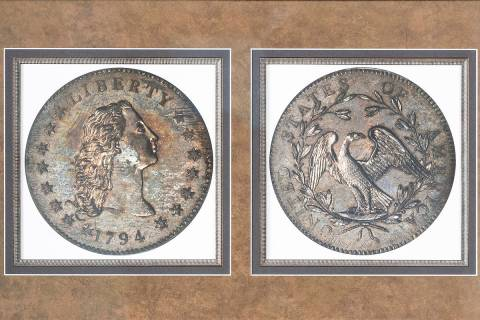 A framed photograph showing the front and back of rare coin collector Bruce Morelan's 1794 silv ...