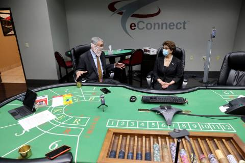EConnect President and CEO Henry Valentino III, left, gives a tour of his Las Vegas business to ...