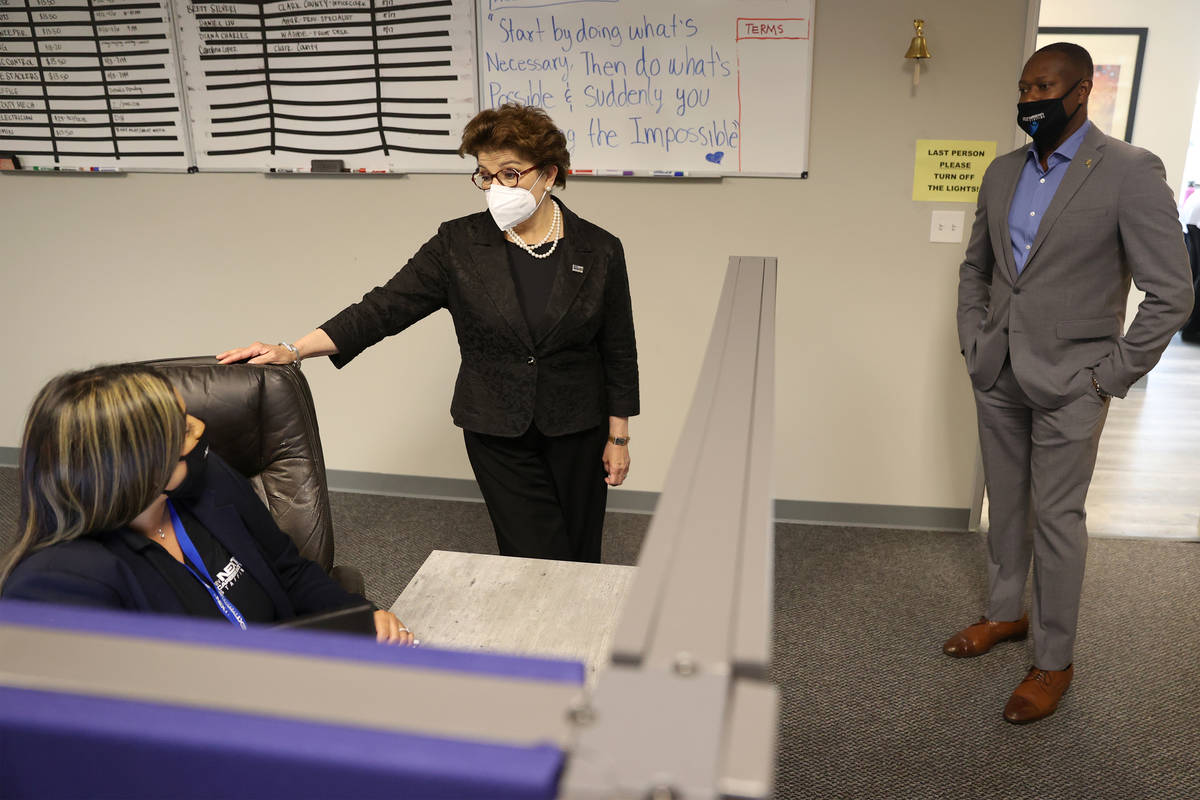 Renee Boyce, right, president of My Next Career Path Staffing, looks on as his recruiting manag ...