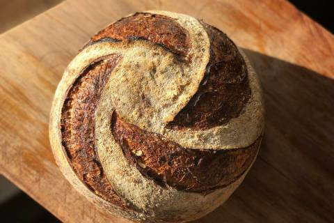 Classic country sourdough is a mixture of American stone ground organic flour, salt and the cou ...