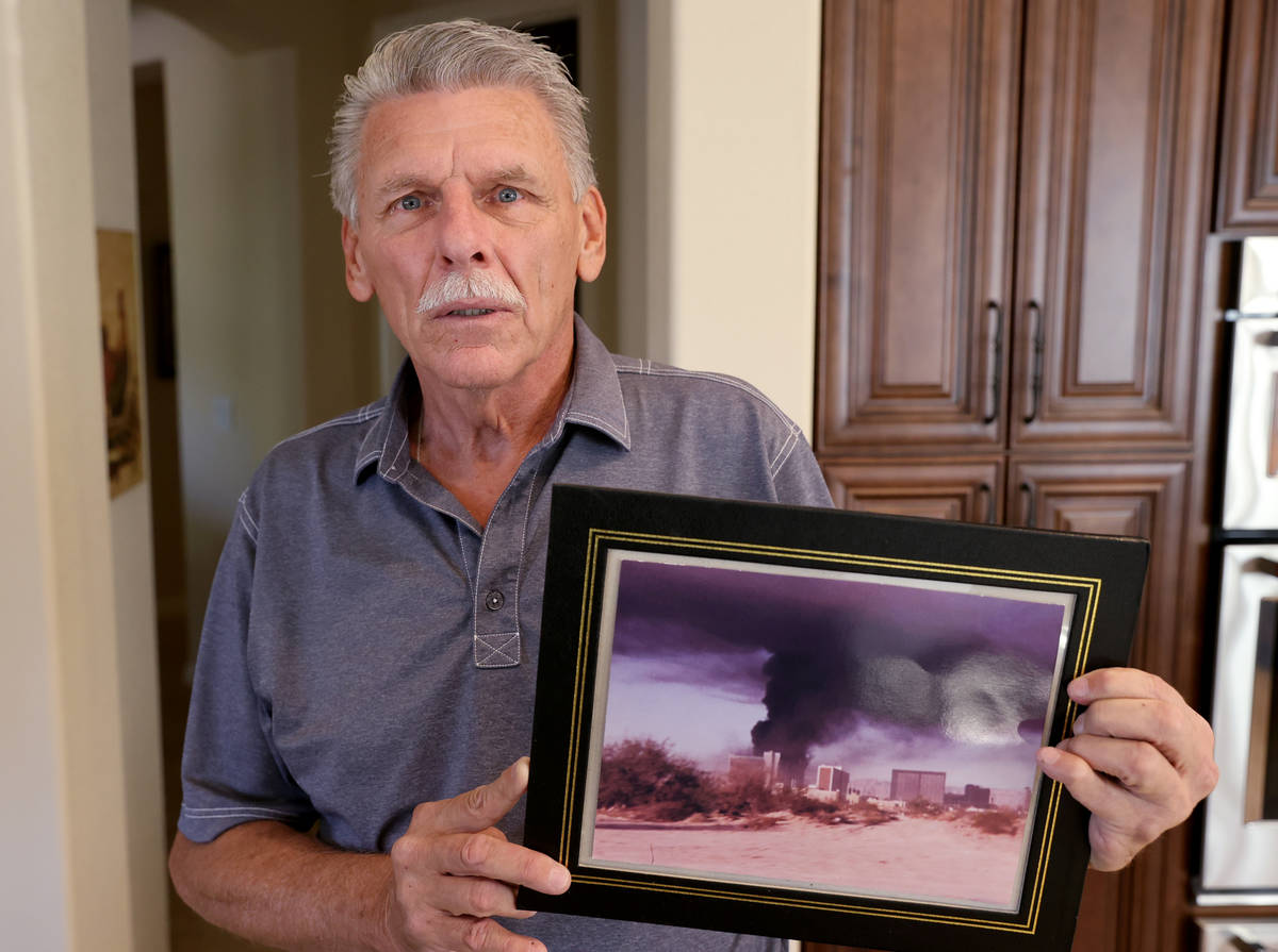 Retired Clark County Fire Department Capt. Jerry Bendorf shows a photo of the MGM Grand fire at ...