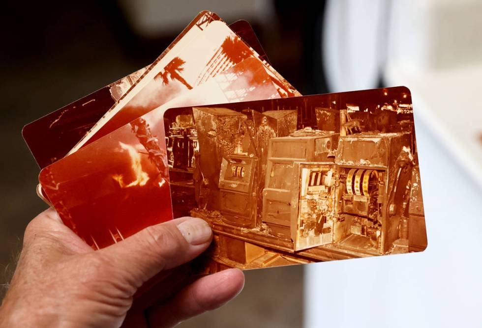 Charlie Lombardo, 72, shows photos from the MGM Grand fire in his Henderson home on Nov. 2, 202 ...