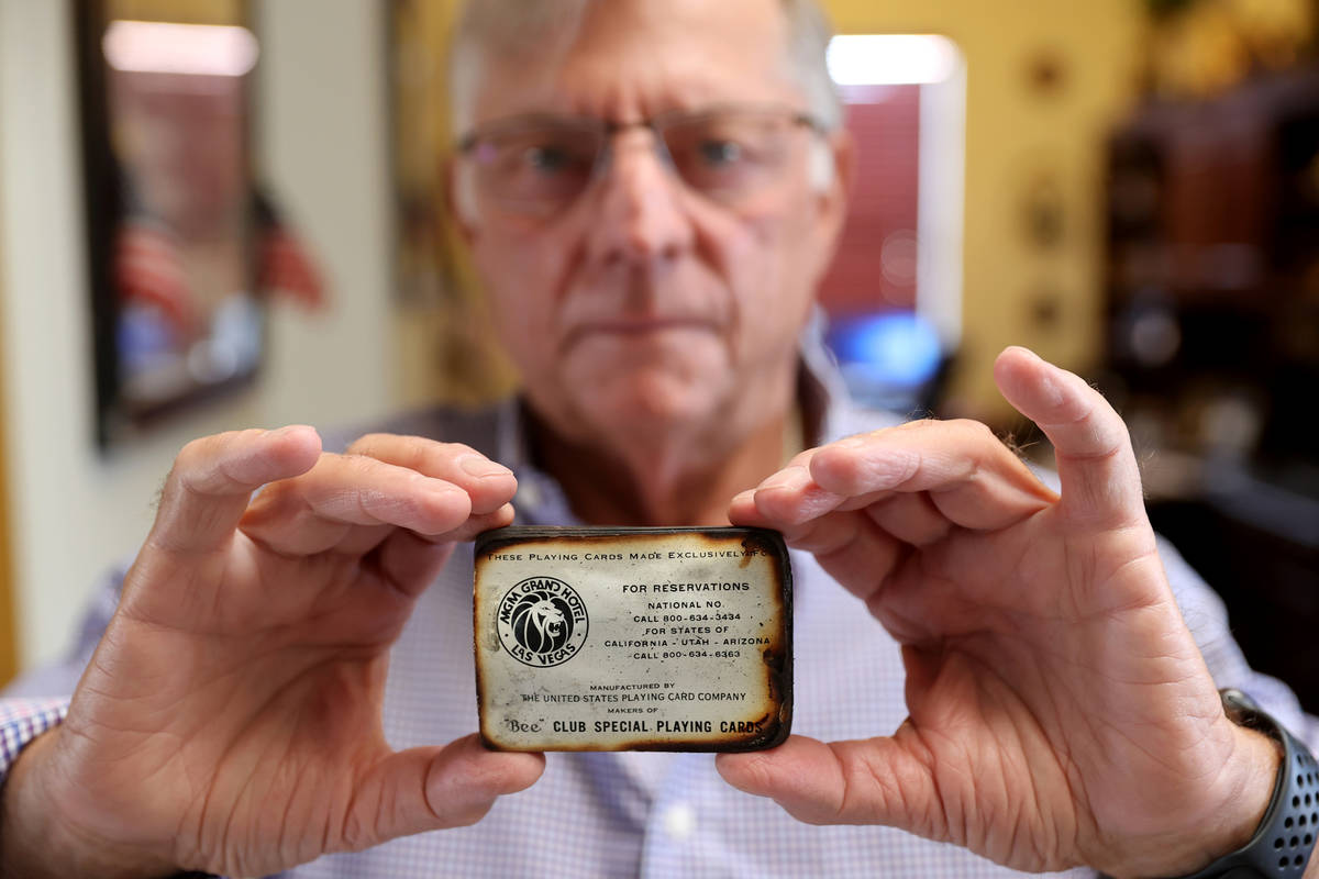Charlie Lombardo, 72, shows a deck of burned playing cards from the MGM Grand in his Henderson ...
