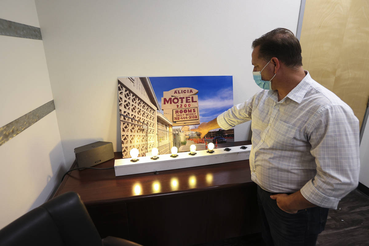 Keith Kochan, account executive at Vision Sign Inc., points to a picture of one of the former A ...