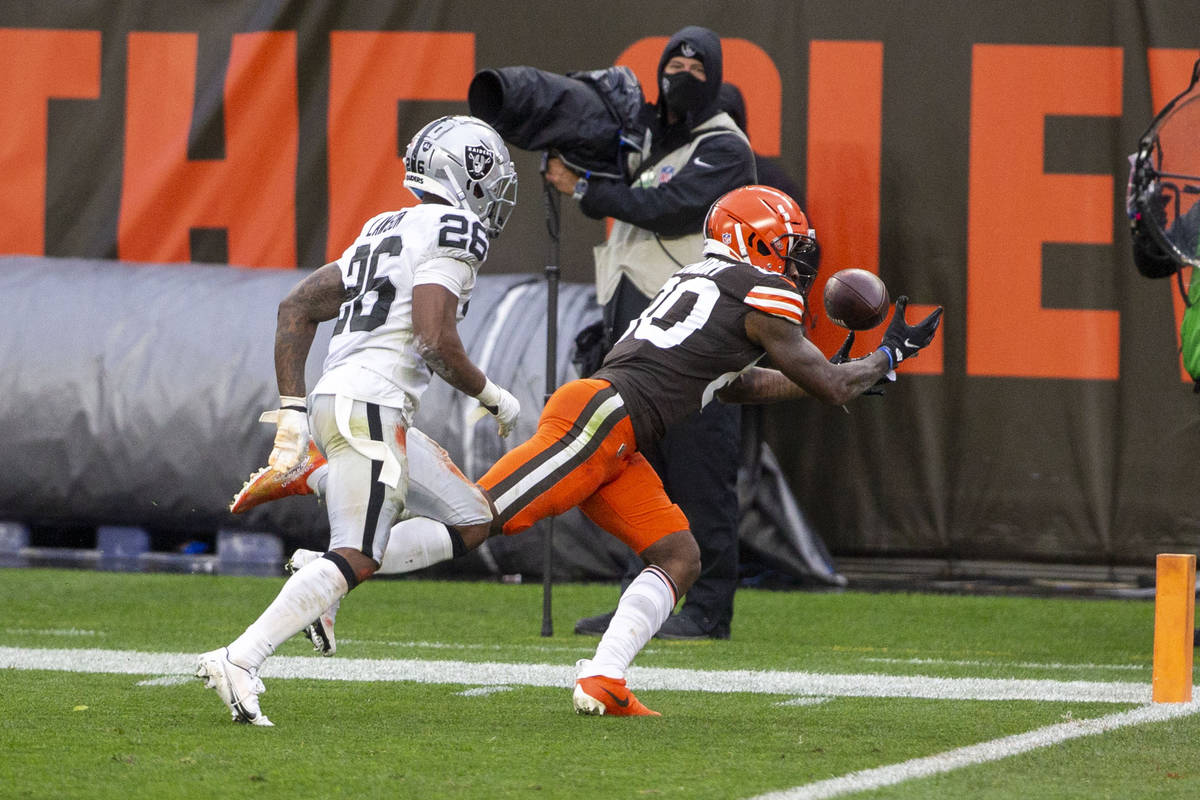 Cleveland Browns wide receiver Jarvis Landry (80) reaches for the football as Las Vegas Raiders ...
