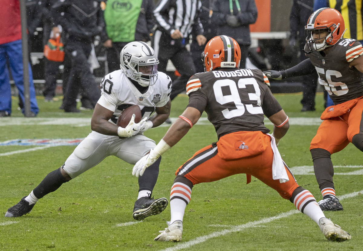 Las Vegas Raiders running back Jalen Richard (30) makes a catch and run against Cleveland Brown ...