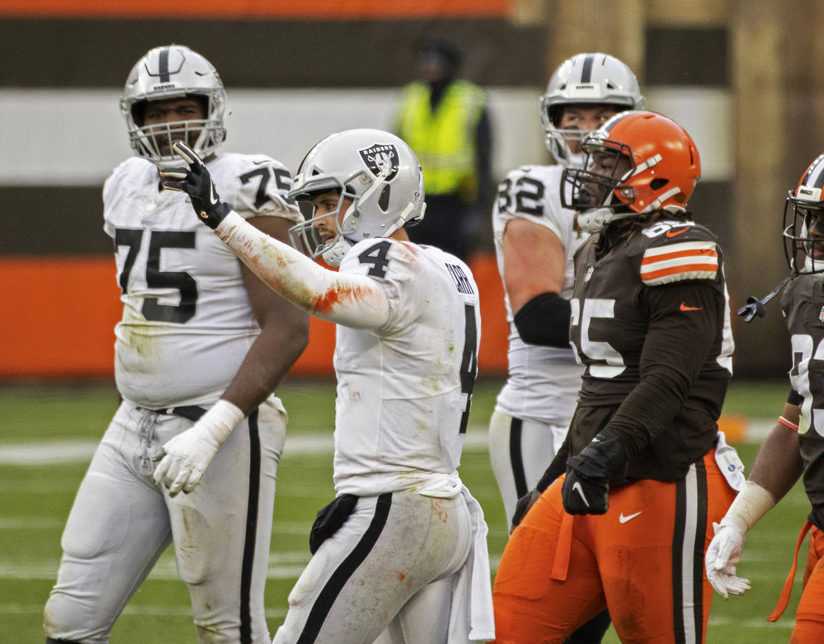 Las Vegas Raiders quarterback Derek Carr (4) celebrates a big play in front of Cleveland Browns ...