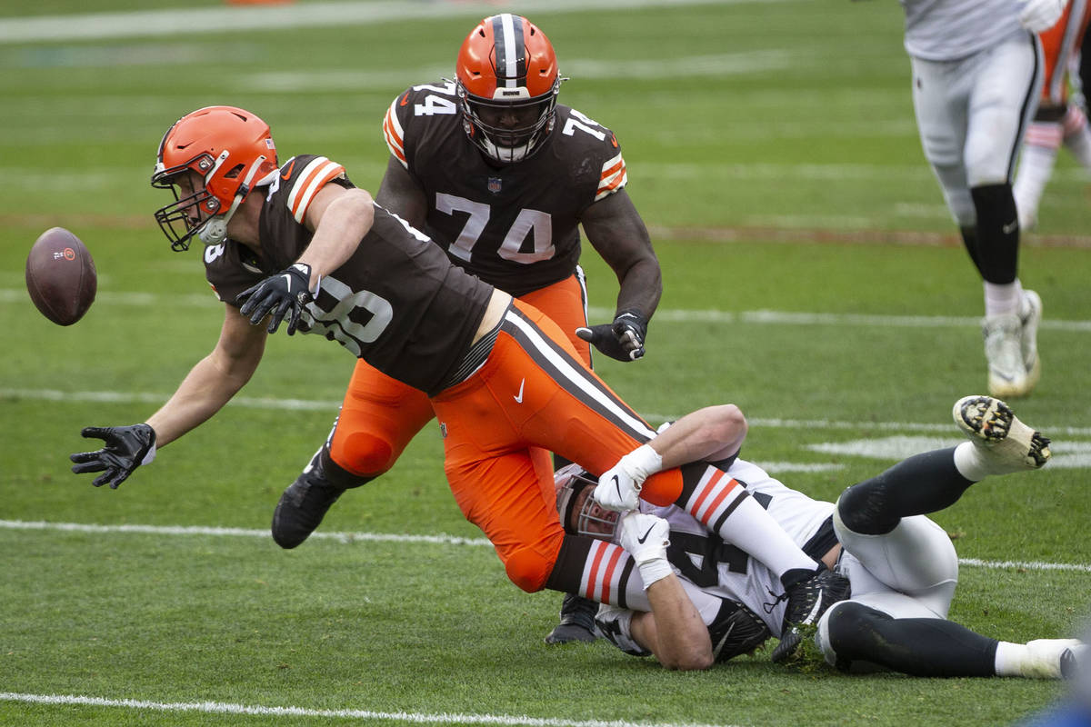 Cleveland Browns tight end Harrison Bryant (88) fumbles the football while being tackled by Las ...