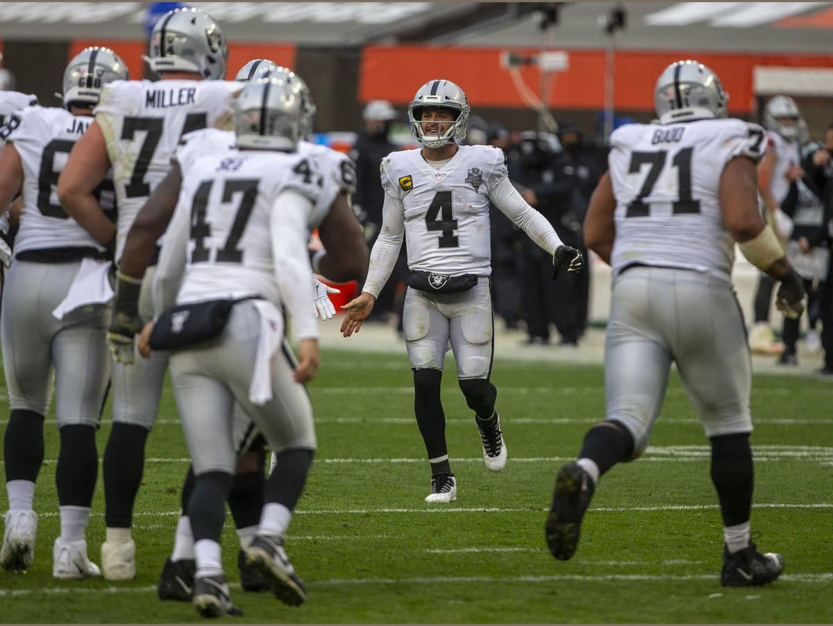 Las Vegas Raiders quarterback Derek Carr (4) comes on the field to congratulate the special tea ...