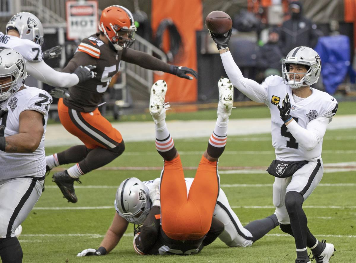 Las Vegas Raiders quarterback Derek Carr (4) makes a throw around pressure from Cleveland Brown ...