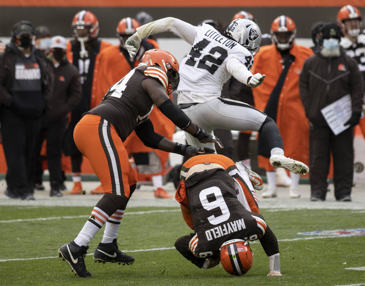 Las Vegas Raiders inside linebacker Cory Littleton (42) leaps over Cleveland Browns quarterback ...