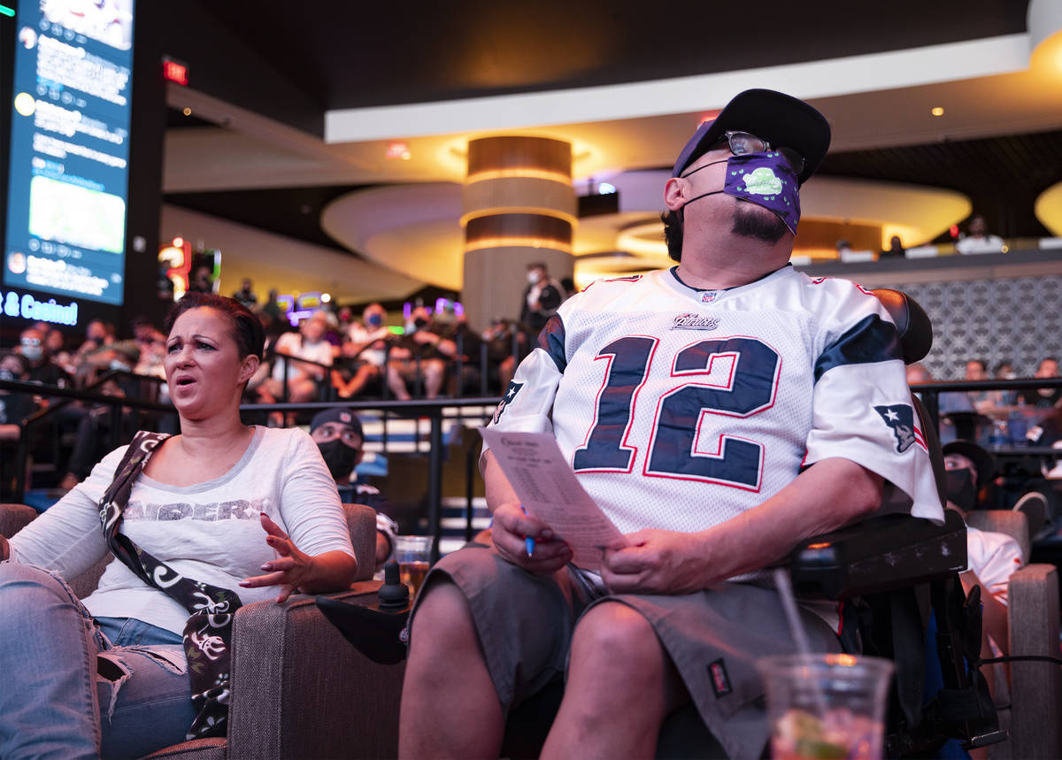 """Jesus """"Chuy"""" Baca, right, watches NFL Sunday at the new sportsbook at Circa in Las Vegas, S ..."""