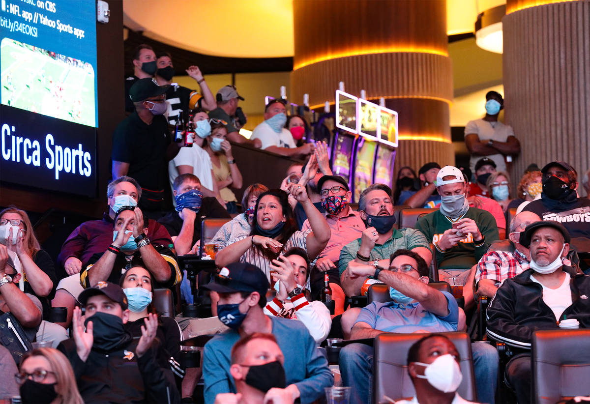 Spectators react to a play while watching NFL Sunday at the new sportsbook at Circa in Las Vega ...