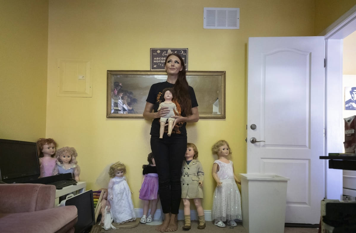 Paranormal enthusiast Staysha Randall is seen in a room connected to her garage that houses ite ...