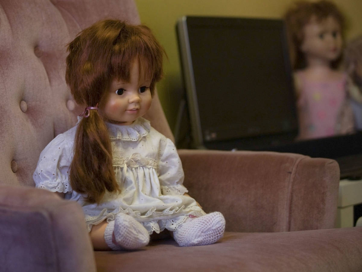 A doll that carries high activity, Katie, sits on a haunted chair in paranormal enthusiast Stay ...