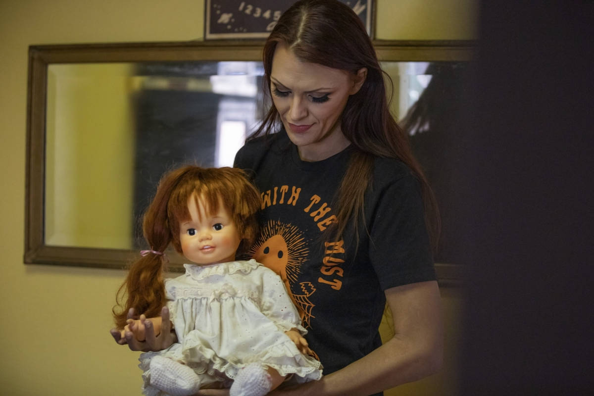 Paranormal enthusiast Staysha Randall is seen in front of a haunted mirror holding a doll named ...