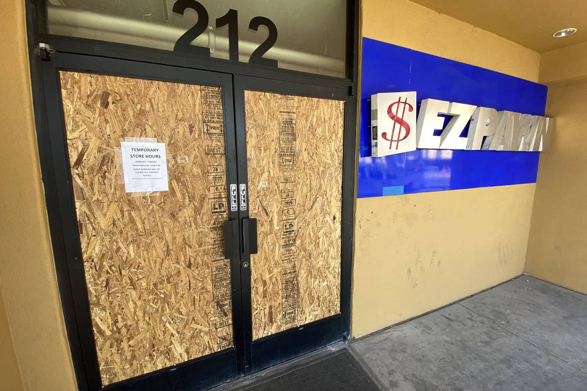 The EZ Pawn on Las Vegas Boulevard that was looted during protests on May 30 is boarded up on E ...
