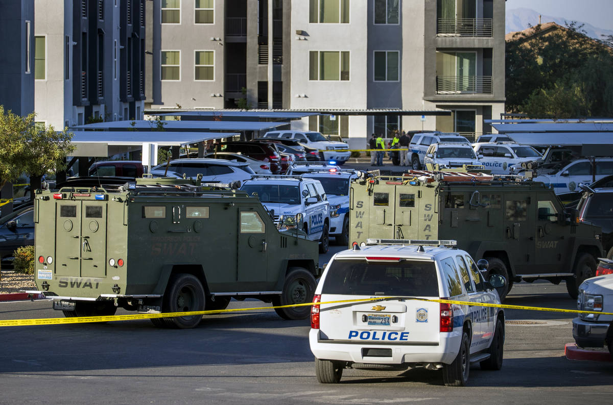 Numerous emergency vehicle as well as SWAT pack the parking lot after four were killed and one ...