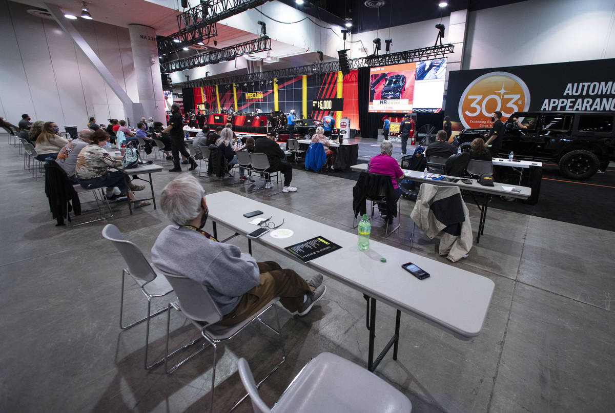 Bidders watch as cars are displayed to be auctioned at the Las Vegas Convention Center where Me ...