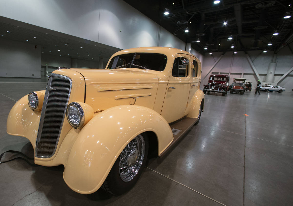 Classic cars, including a 1935 Chevy Master Deluxe Resto Mod, front, are lined up to be auction ...