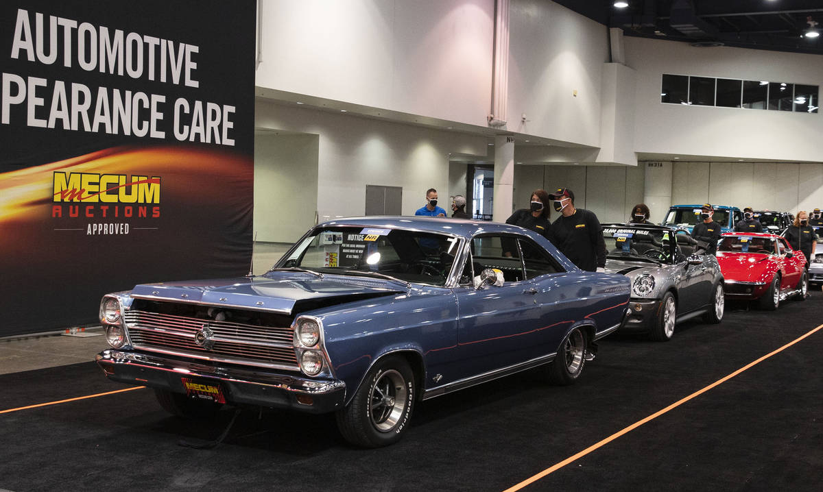 Classic cars, including a 1966 Ford Fairlane 500, front, is displayed to be auctioned at the La ...