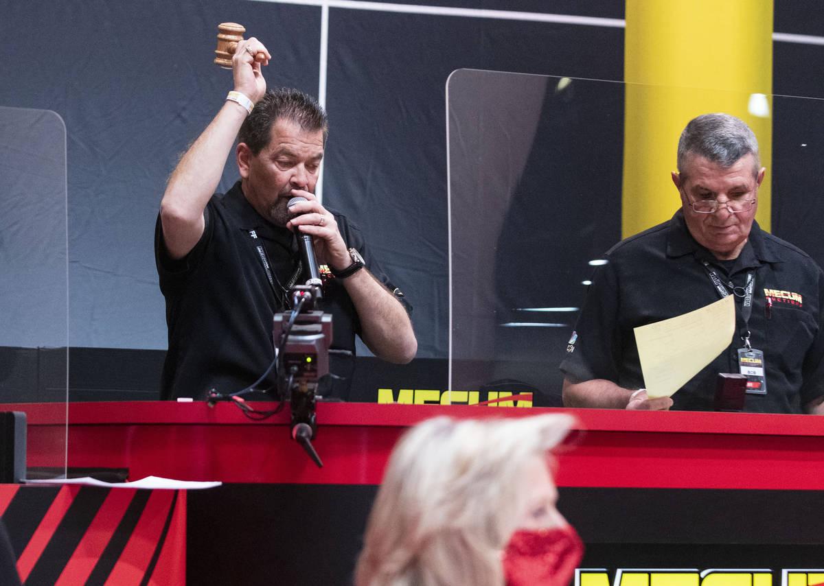Auctioneer Billy Landis, left, takes bids at the Las Vegas Convention Center where Mecum Auctio ...