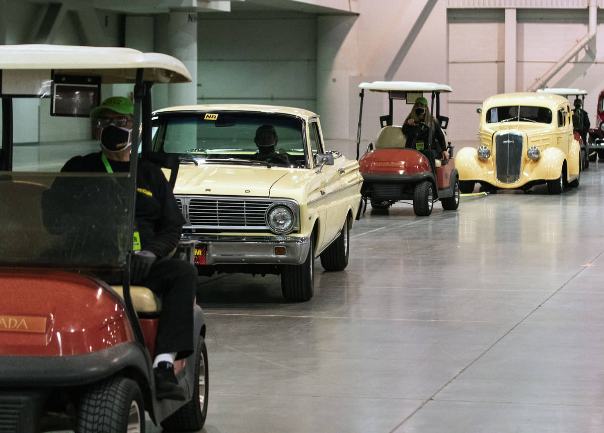 Classic cars are lined up to be auctioned at the Las Vegas Convention Center where Mecum Auctio ...