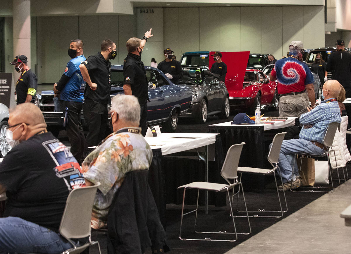 Bidders watch as classic cars are displayed to be auctioned at the Las Vegas Convention Center ...