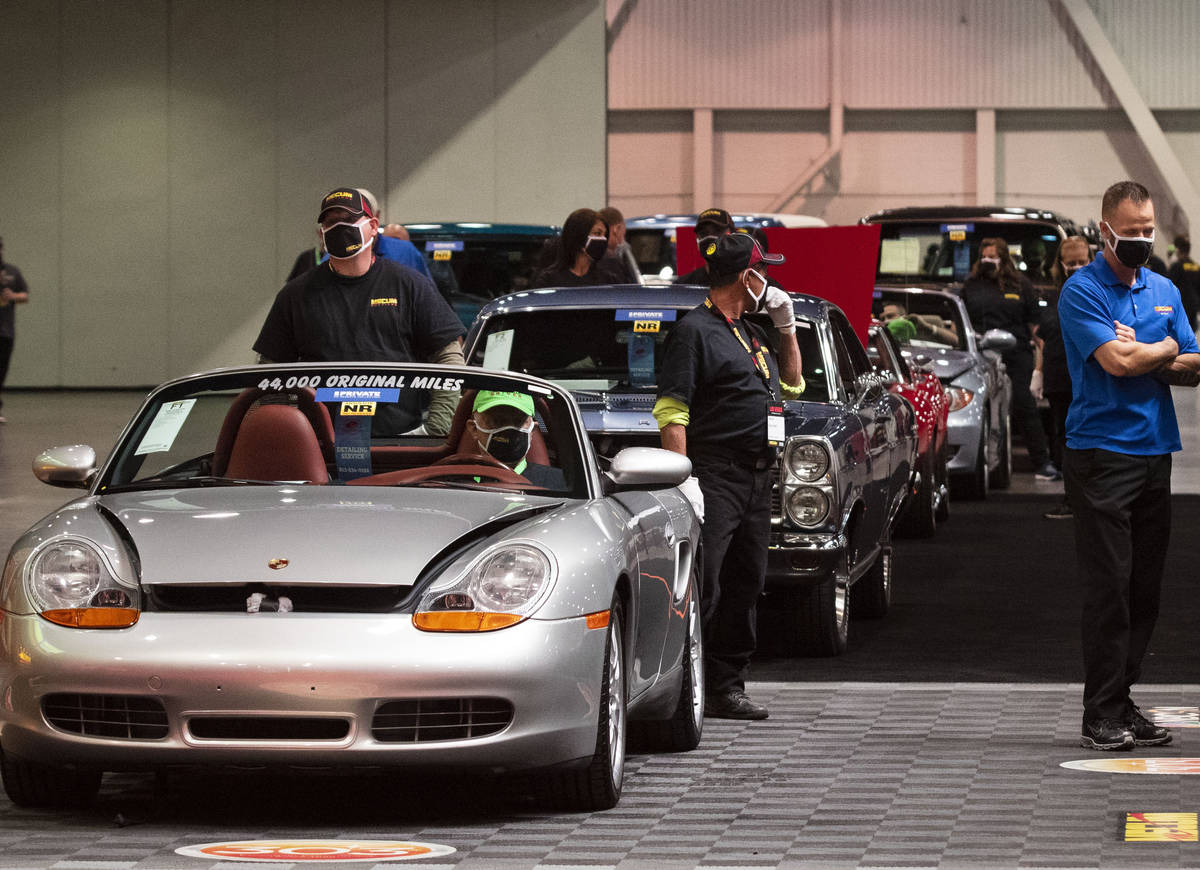 Classic cars are displayed to be auctioned at the Las Vegas Convention Center where Mecum Aucti ...