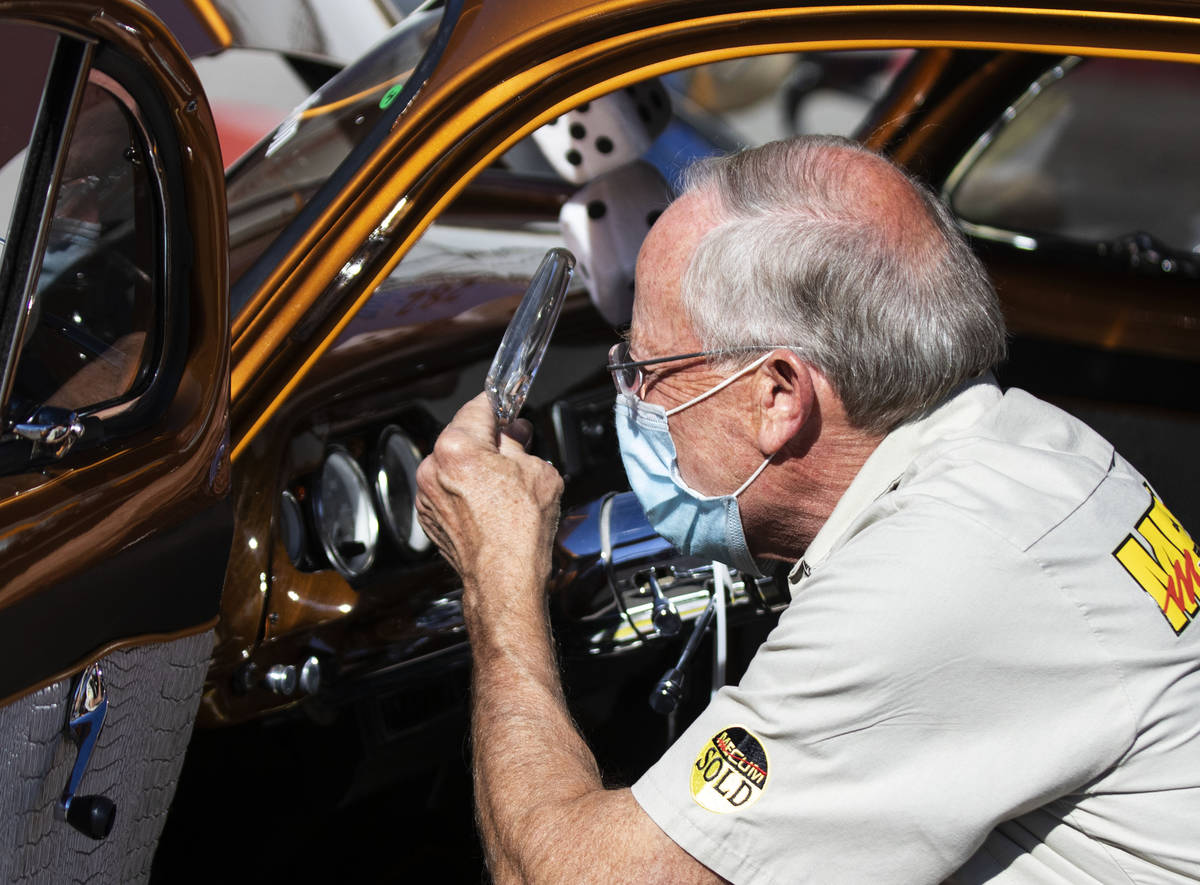 Greg Korcyl, VIN inspector, inspects a 1952 Chevy Business Coupe as cars are lined up to be ins ...
