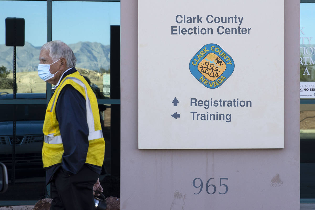 A security guard stands outside of the Clark County Election Center on Wednesday, Nov. 4, 2020, ...