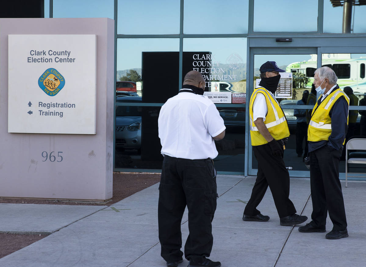 Security guards stand outside of the Clark County Election Center on Wednesday, Nov. 4, 2020, i ...