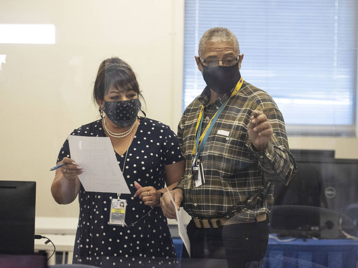 Clark County election workers conduct certification of the counting system at the Election Cent ...