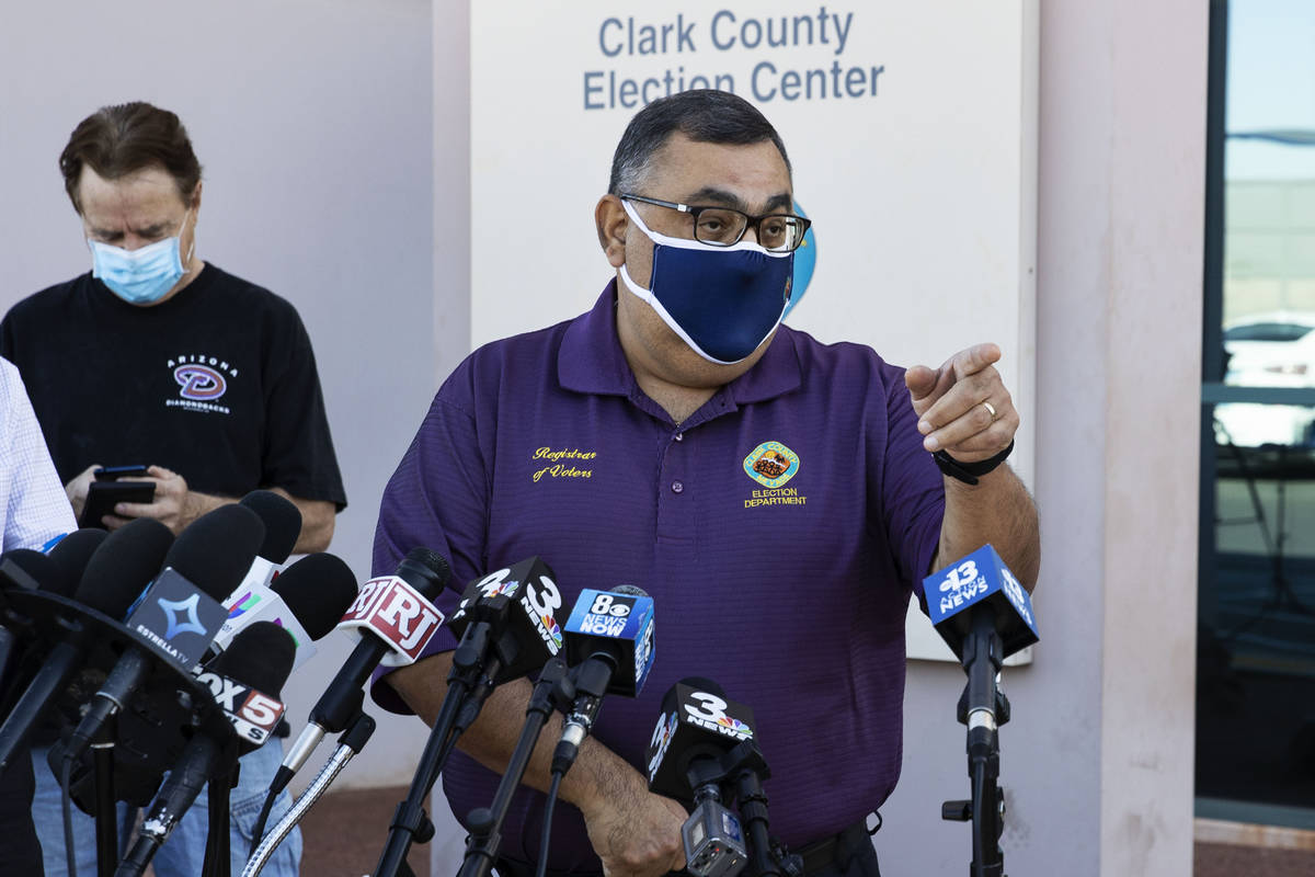 Clark County Registrar, Joe Gloria, provides a brief update to the media outside of the Electio ...