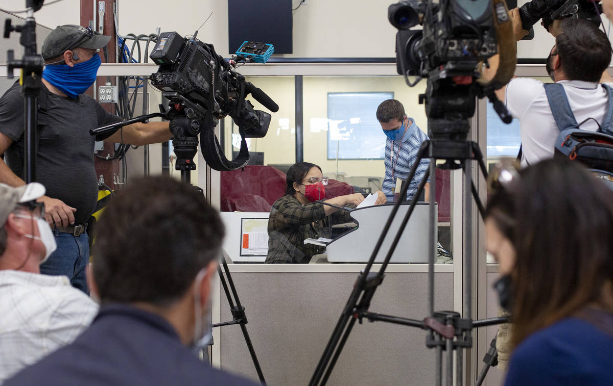 The media documents as mail-in ballots are counted at Clark County Election Center on Wednesday ...