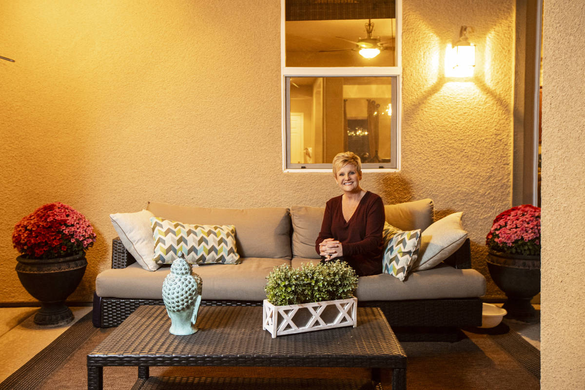 Allyson Johnson, who is in the process of selling her home and buying a new one, poses for a po ...