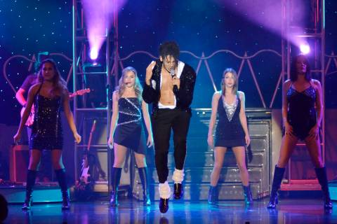 """Jalles Franca, center, performs as Michael Jackson during """"MJ Live"""" in the showroom at the Stra ..."""
