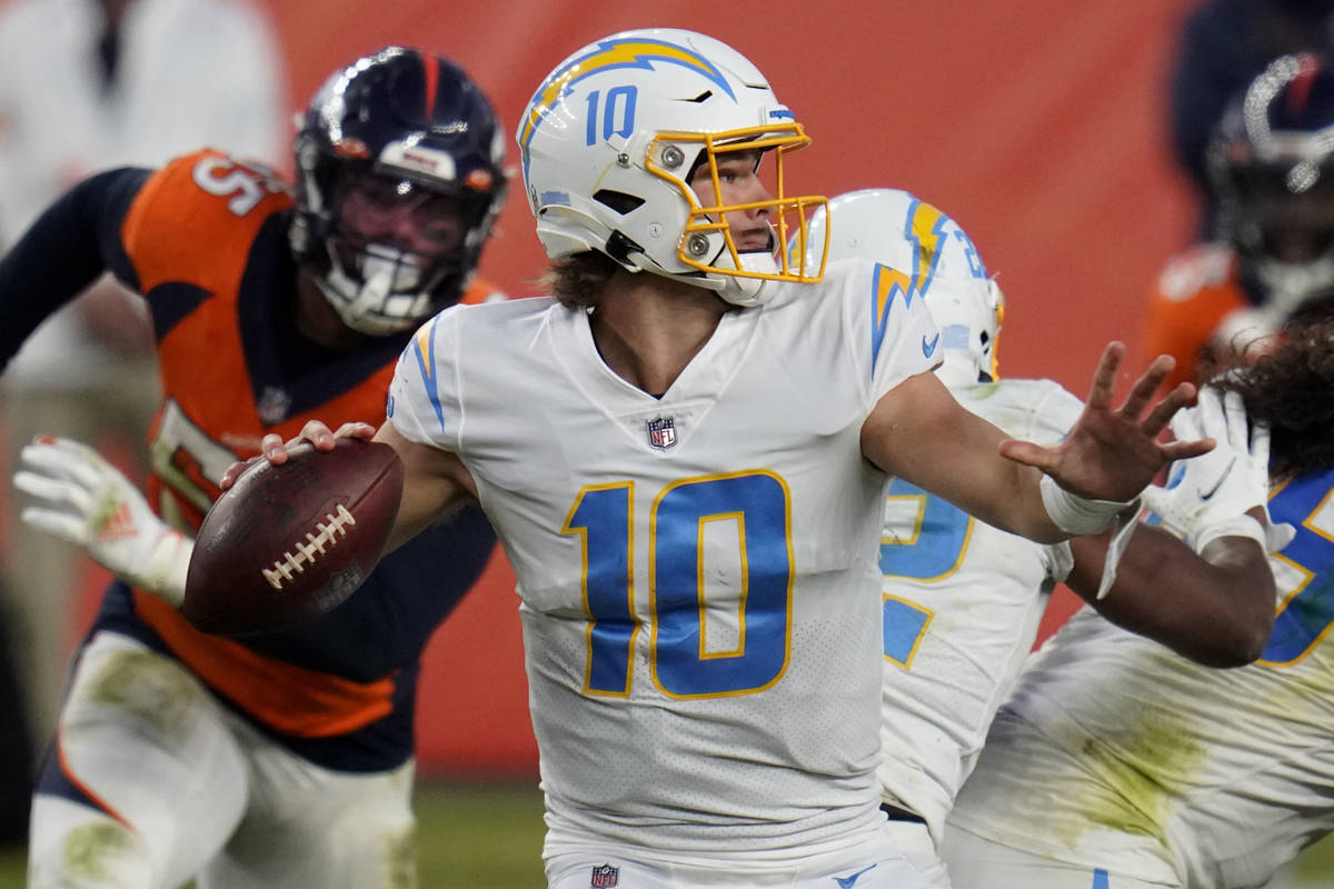 Los Angeles Chargers quarterback Justin Herbert (10) throws against the Denver Broncos during t ...
