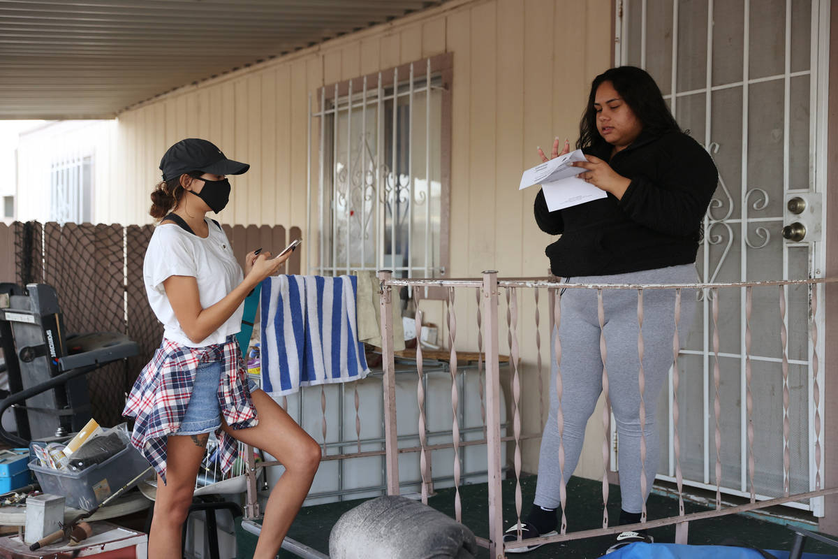 Miriam Almonte, right, 20, receives information from April Kacura, field organizer for the Neva ...