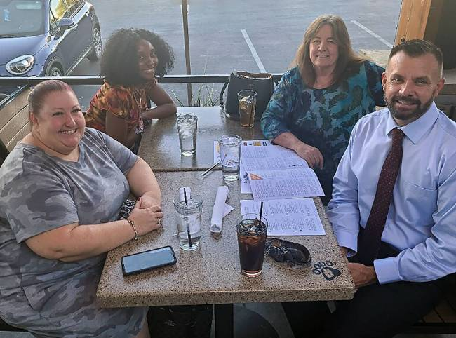 Michael Russell, bottom right, at a celebratory lunch after he was granted a full pardon on Wed ...