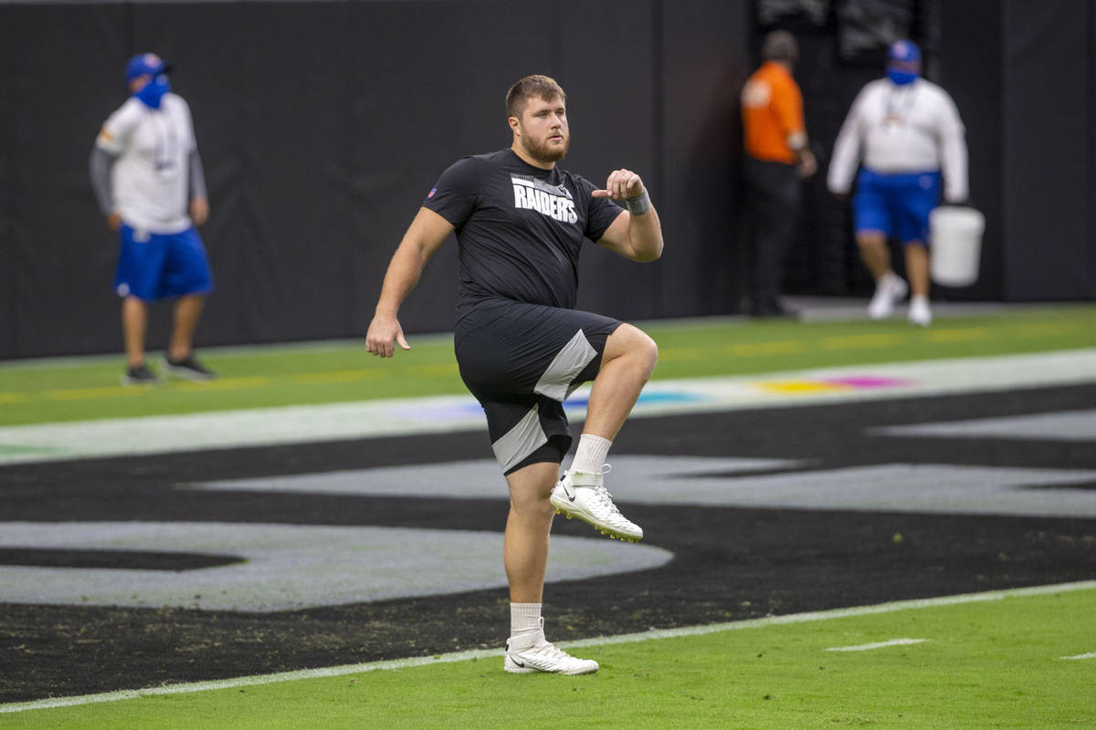 Las Vegas Raiders offensive tackle Kolton Miller (74) warms up before an NFL football game agai ...