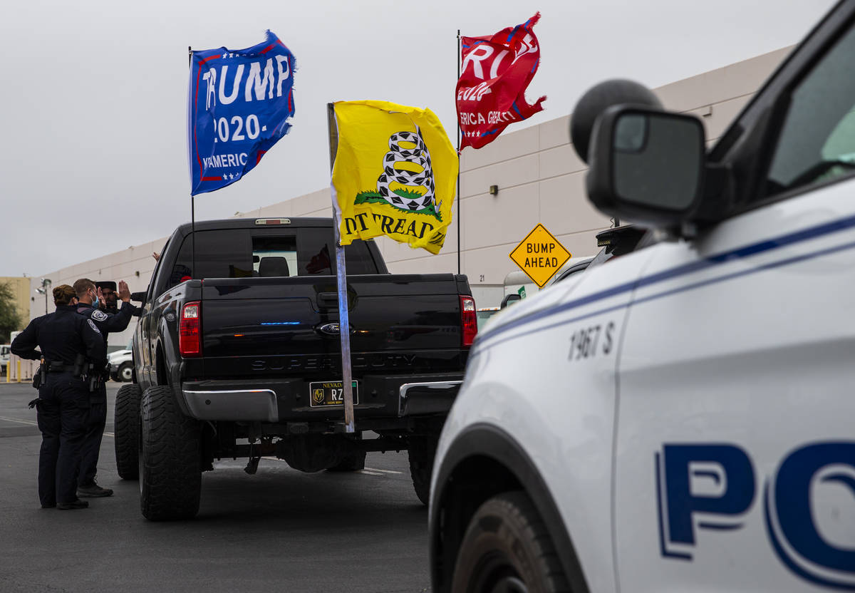 North Las Vegas police stop supporters of President Donald Trump in the parking lot of the Clar ...