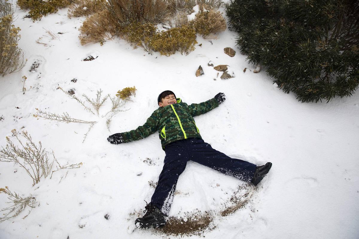 Marshall Byrd, 7, makes a snow angel at Mt. Charleston on Sunday, Nov. 8, 2020. Saturday&#x2019 ...