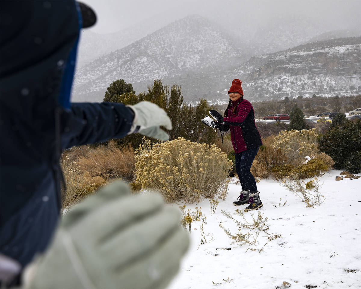 Jamie Byrd, center, prepares to throw a snowball at her husband Marshall Byrd, left, at Mt. Cha ...