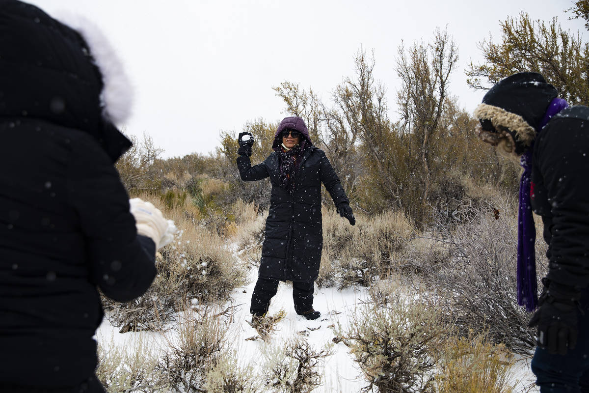 Cassandra Gonzalez throws a snowball at her family at Mt. Charleston on Sunday, Nov. 8, 2020. S ...
