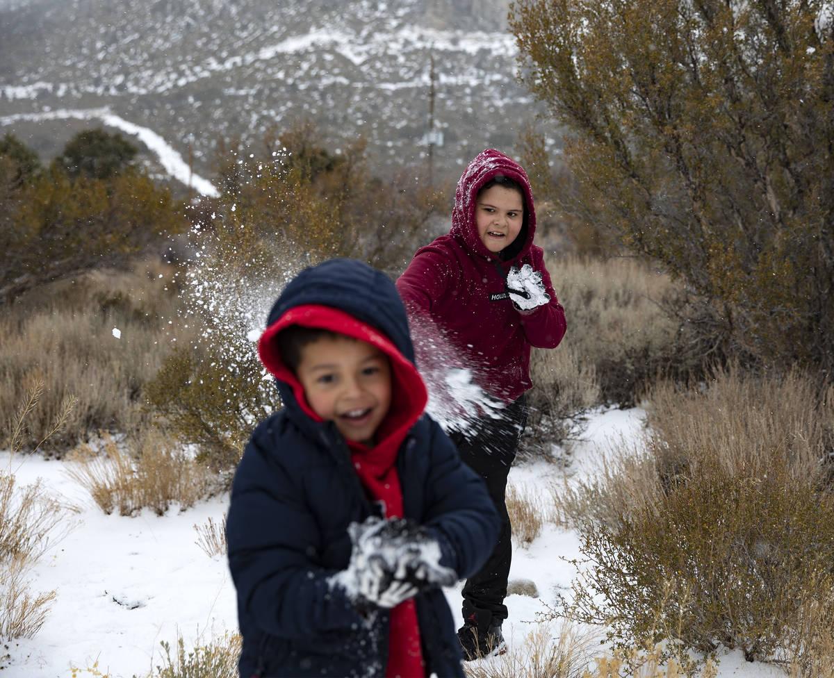 Max Vasquez, 10, throws a snowball at Joan Vasquez, 5, as they play at Mt. Charleston, Sunday, ...
